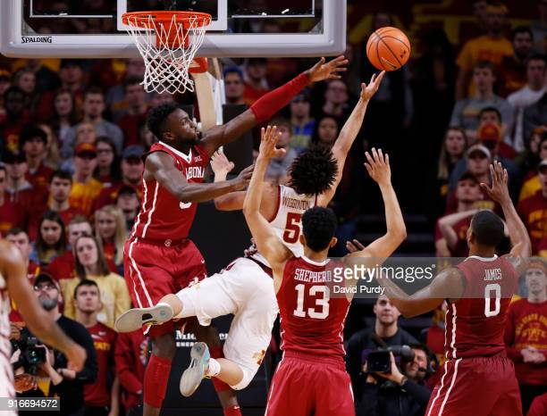 Lindell Wigginton of the Iowa State Cyclones takes a shot as Khadeem Lattin Jordan Shepherd and Christian James of the Oklahoma Sooners in the second...