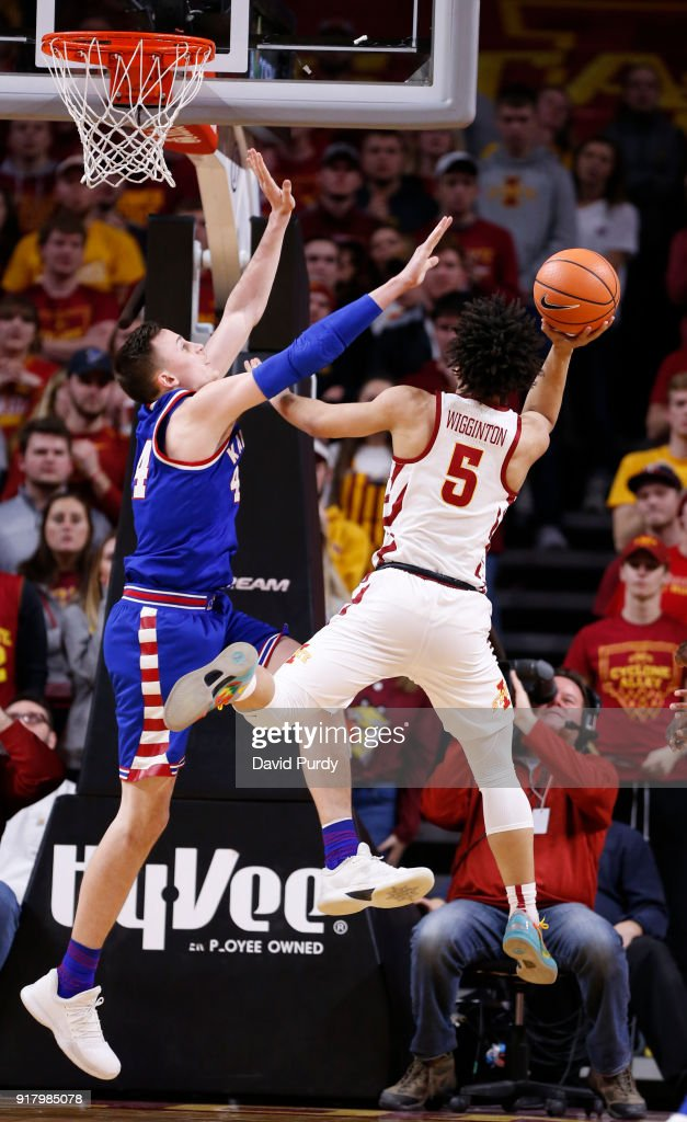Lindell Wigginton #5 of the Iowa State Cyclones takes a shot as Mitch Lightfoot #44 of the Kansas Jayhawks blocks in the second half of play at Hilton Coliseum on February 13, 2018 in Ames, Iowa. The Kansas Jayhawks won 83-77 over the Iowa State Cyclones.