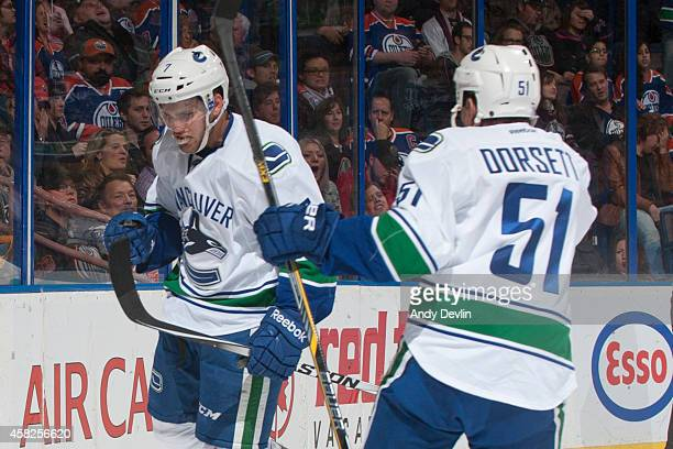 Linden Vey and Derek Dorsett of the Vancouver Canucks celebrate after a goal against the Edmonton Oilers on November 1 2014 at Rexall Place in...