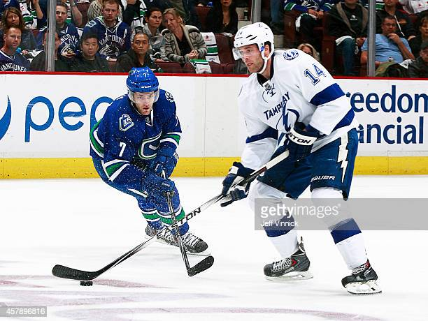 Linden Vey of the Vancouver Canucks and Brett Connolly of the Tampa Bay Lightning battle for a loose puck during their NHL game at Rogers Arena...