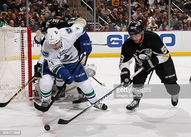 Linden Vey of the Vancouver Canucks and Kris Letang of the Pittsburgh Penguins battle for the loose puck during the first period at Consol Energy...