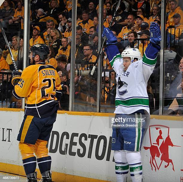Linden Vey of the Vancouver Canucks celebrates after scoring a goal against the Nashville Predators during the second period at Bridgestone Arena on...
