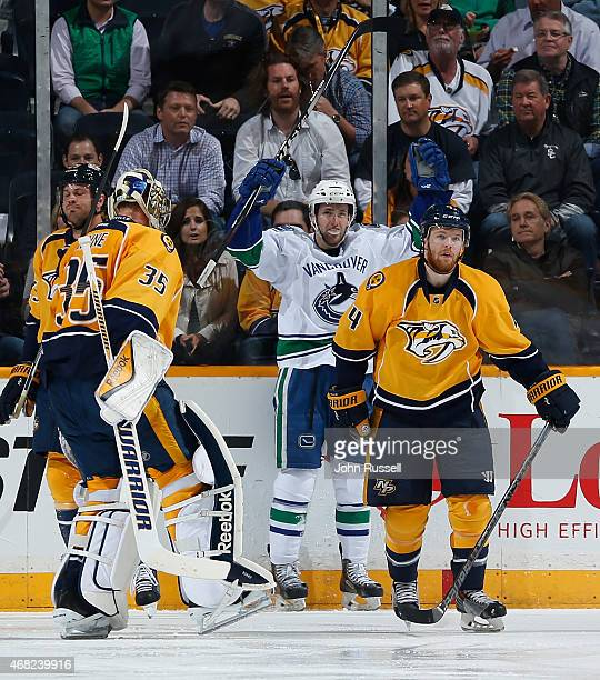 Linden Vey of the Vancouver Canucks celebrates his goal against Pekka Rinne and Ryan Ellis of the Nashville Predators during an NHL game at...