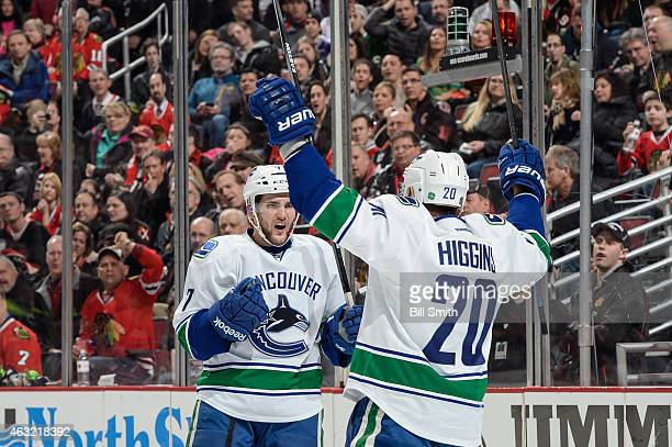 Linden Vey of the Vancouver Canucks celebrates with Chris Higgins after scoring against the Chicago Blackhawks in the second period during the NHL...