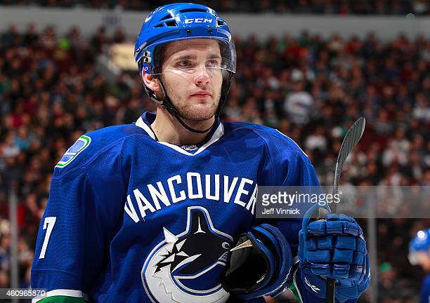Linden Vey of the Vancouver Canucks looks on from the bench during their NHL game against the Dallas Stars at Rogers Arena December 17 2014 in...
