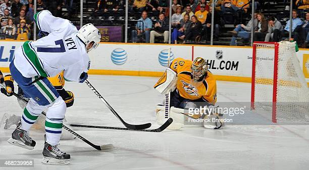 Linden Vey of the Vancouver Canucks scores a goal against Pekka Rinne of the Nashville Predators during the second period at Bridgestone Arena on...