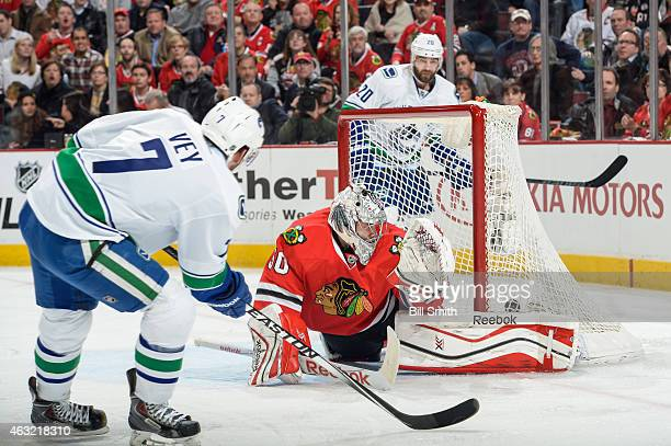 Linden Vey of the Vancouver Canucks scores on goalie Corey Crawford of the Chicago Blackhawks in the second period during the NHL game at the United...