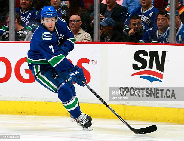Linden Vey of the Vancouver Canucks skates up ice with the puck during their NHL game against the Edmonton Oilers at Rogers Arena October 11 2014 in...