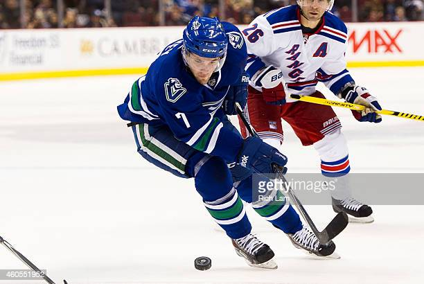 Linden Vey of the Vancouver Canucks skates with the puck during NHL action against the New York Rangers at Rogers Arena on December 13 2014 in...