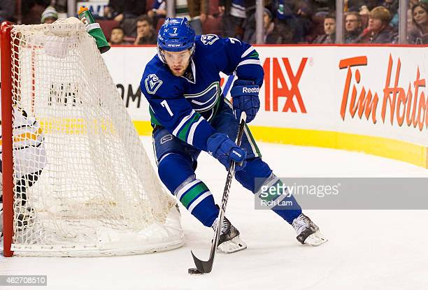 Linden Vey of the Vancouver Canucks skates with the puck in NHL action against the Buffalo Sabres in Vancouver BC on January 2015 at Rogers Arena in...