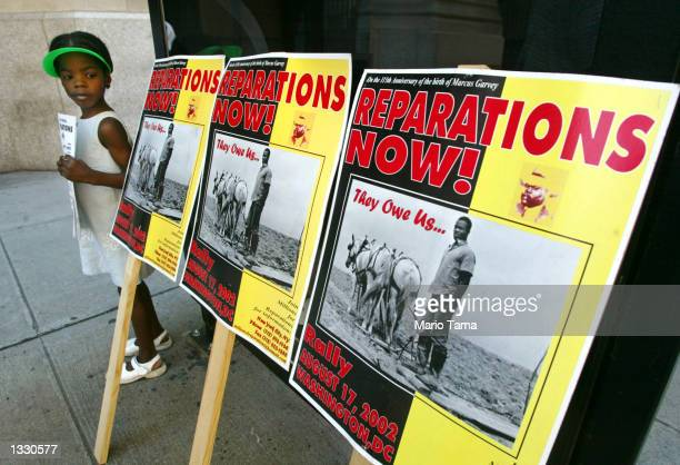 Lindi Bobb attends a slavery reparations protest outside New York Life Insurance Company offices August 9 2002 in New York City Protesters claim the...