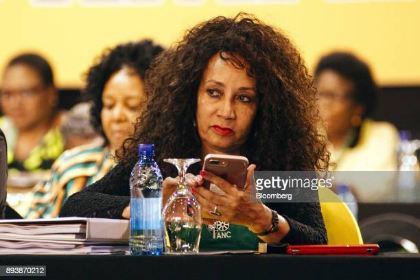 Lindiwe Sisulu South Africa's minister for human settlements uses a smartphone during the 54th national conference of the African National Congress...