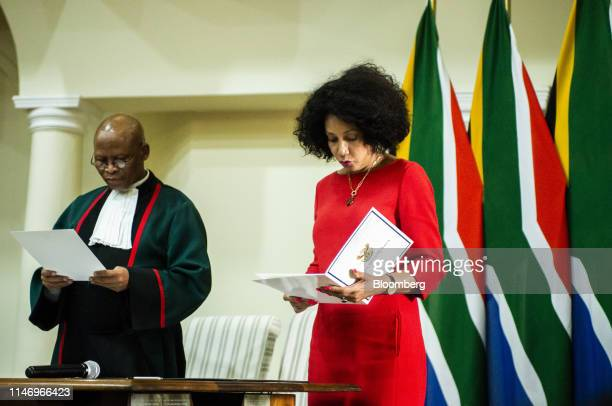 Lindiwe Sisulu South Africa's social development minister right speaks during a swearingin ceremony in Pretoria South Africa on Thursday May 30 2019...
