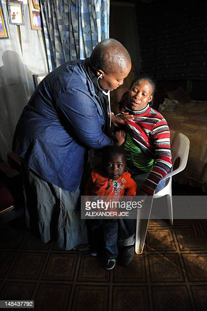 Lindiwe's is checked by a doctor on May 16 2012 at her home in Soweto with her threeyearold son Siyabonga who is HIV positive in spite of...