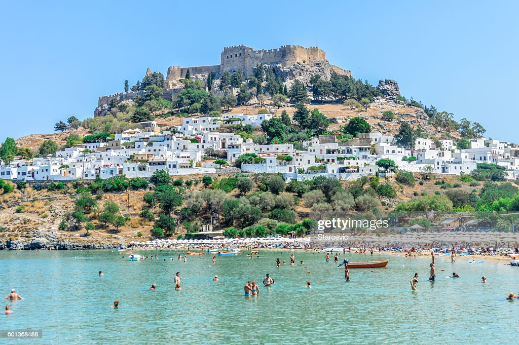 Lindos beach with Acropolis in the background - Rhodes, Greece : Stock Photo