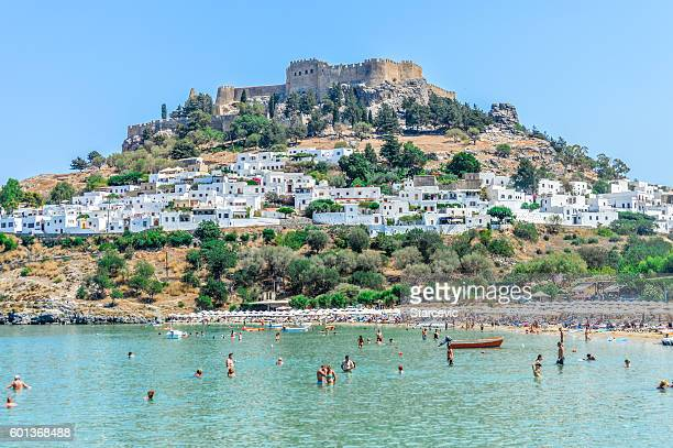 lindos beach with acropolis in the background - rhodes, greece - old ruin stock photos and pictures