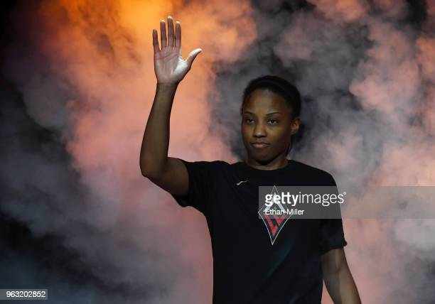 Lindsay Allen of the Las Vegas Aces waves as she is introduced before the Aces' inaugural regularseason home opener against the Seattle Storm at the...