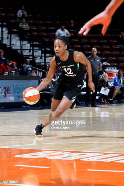 Lindsay Allen of the New York Liberty handles the ball against the Dallas Wings during a preseason game on May 7 2018 at Mohegan Sun Arena in...