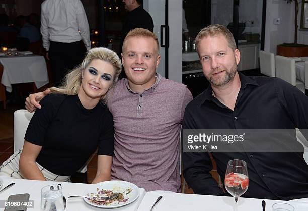 Lindsay Arnold Cusick Sam Cusick and Bob Olejar attend Emma Slater And Sasha Farber's Engagement Dinner at Fig Olive on October 31 2016 in West...