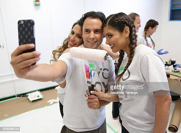 Lindsay Casinelli Alejandro Berry and Chiquinquira Delgado are seen during Univision's Media Centers/Week of Service at Ruben Dario Middle School on...