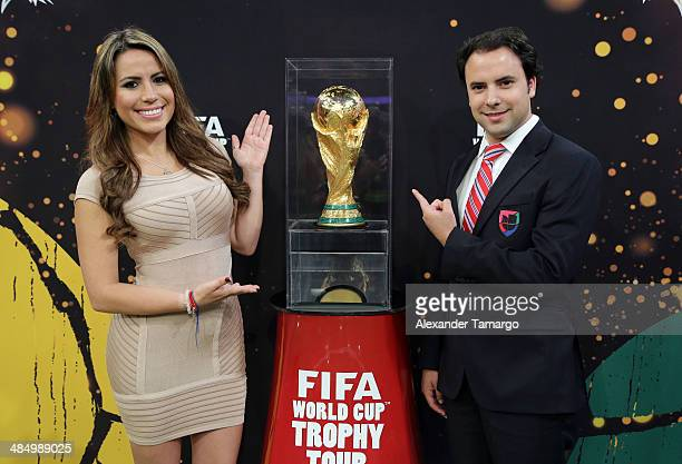 Lindsay Casinelli and Alejandro Berry pose during FIFA World Cup Trophy Tour at Univision Headquarters on April 15 2014 in Miami Florida