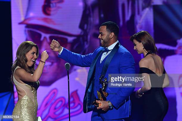 Lindsay Casinelli and Nelson Cruz onstage at the inaugural Premios Univision Deportes at Univision Studios on December 18 2014 in Miami Florida