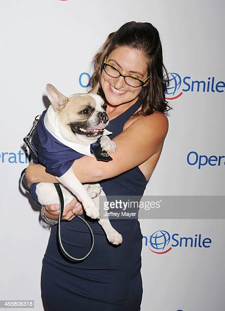Lindsay Condefer and Ambassadog Lentil attend the 2014 Operation Smile Gala at the Beverly Wilshire Four Seasons Hotel on September 19, 2014 in...