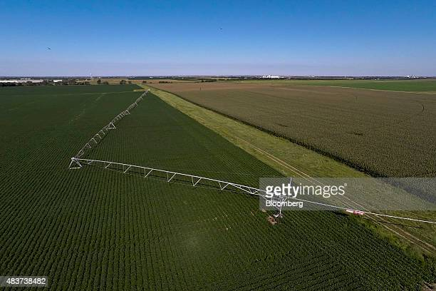 A Lindsay Corp Zimmatic center pivot irrigation system sits in a field in this aerial photograph outside Omaha Nebraska US on Wednesday Aug 12 2015...