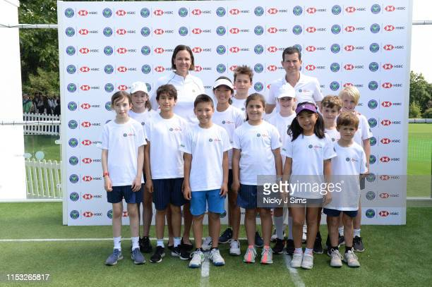 Lindsay Davenport and Tim Henman with children from Give It Your Max during a Wimbledon press conference with a twist on HSBC's Court 20 at Wimbledon...