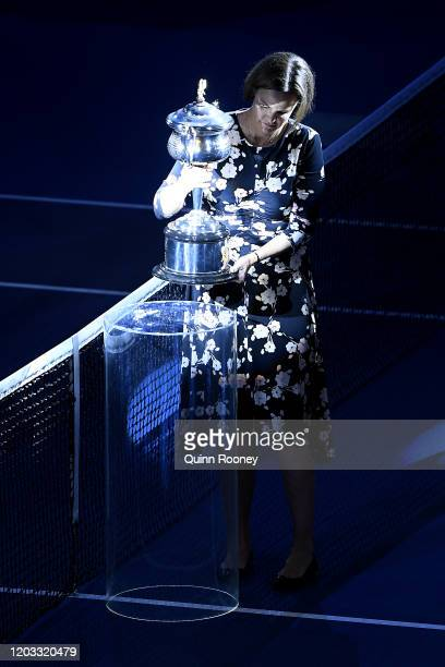 Lindsay Davenport brings out the Daphne Akhurst Memorial Cup onto Rod Laver Arena before the Women's Singles Final match between Sofia Kenin of the...