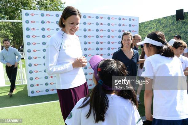 Lindsay Davenport meets children from Give It Your Max during a Wimbledon press conference with a twist on HSBC's Court 20 at Wimbledon on July 2...