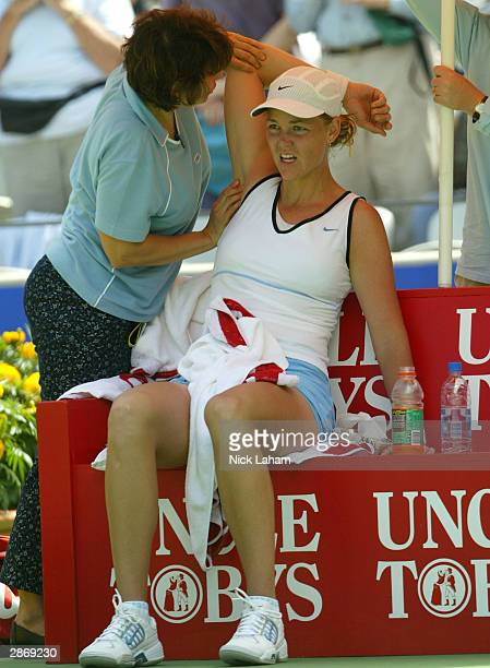 Lindsay Davenport of the United States has treatment on her shoulder from a trainer in her match against Elena Dementieva of Russia during the Adidas...