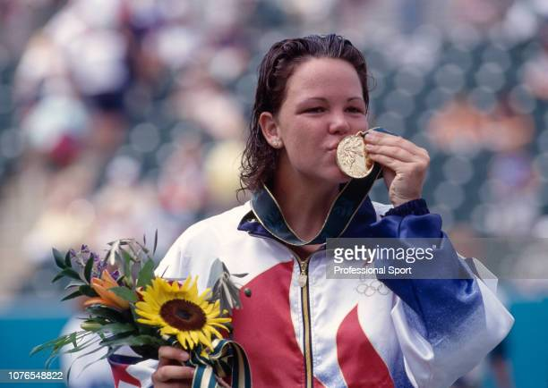 Lindsay Davenport of the United States kissing her Gold Medal after winning the women's singles final against Arantxa Sanchez Vicario of Spain during...