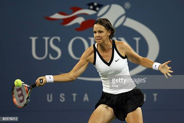 Lindsay Davenport of the United States returns a shot against Alisa Kleybanova of Russia during Day 3 of the 2008 US Open at the USTA Billie Jean...