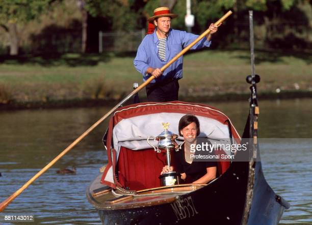Lindsay Davenport of the USA enjoys a gondola trip down the Yarra River with her trophy after defeating Martina Hingis of Switzerland in the Women's...