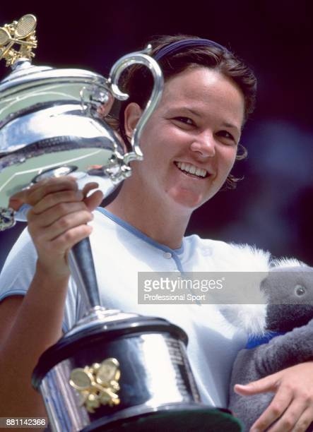 Lindsay Davenport of the USA poses with the trophy after defeating Martina Hingis of Switzerland during the Women's Singles Final of the Australian...