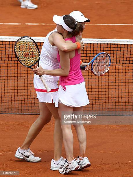 Lindsay Davenport of USA and Martina Hingis of Switzerland celebrate match point during the women's legends final match between Lindsay Davenport of...