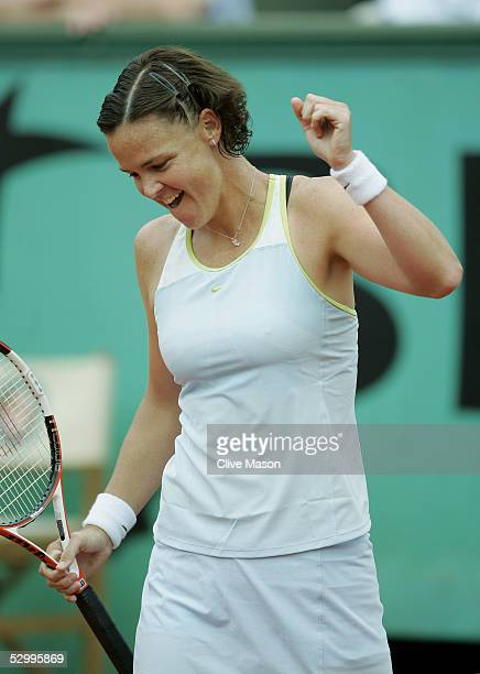 Lindsay Davenport of USA celebrates defeating Kim Clijsters of Belgium during her fourth round match against Kim Clijsters of Belgium on the seventh...