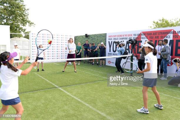 Lindsay Davenport plays some tennis with children from Give It Your Max during a Wimbledon press conference with a twist on HSBC's Court 20 at...