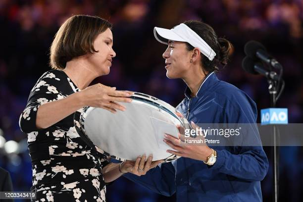 Lindsay Davenport presents Garbine Muguruza of Spain with the runners up plate after her Women's Singles Final match against Sofia Kenin of the...