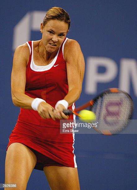 Lindsay Davenport returns a shot to Kim Clijsters of Belgium during the US Open on September 5, 2003 at the USTA National Tennis Center, Flushing...