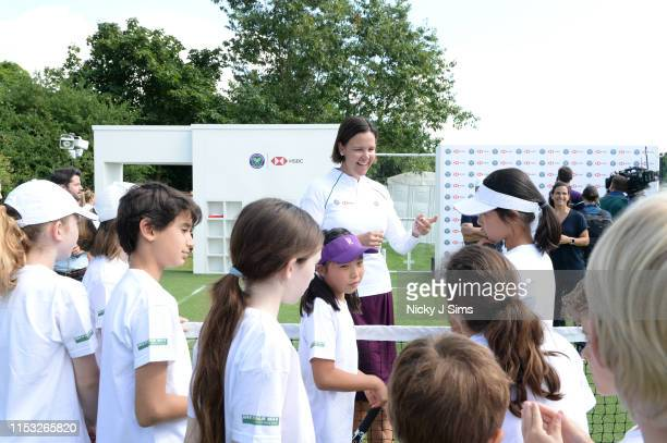 Lindsay Davenport talks with children from Give It Your Max during a Wimbledon press conference with a twist on HSBC's Court 20 at Wimbledon on July...