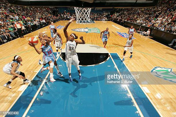 Lindsay harding of the Atlanta Dream drives to the basket against Rebekkah Brunson of the Minnesota Lynx in Game One of the 2011 WNBA Finals on...