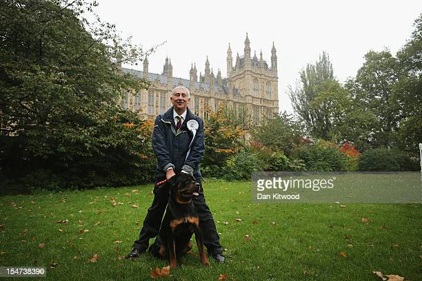 Lindsay Hoyle Labour MP for Chorley stands in front of The Houses of Parliament with his dog Gordon a Rottweiler during the Westminster Dog of The...