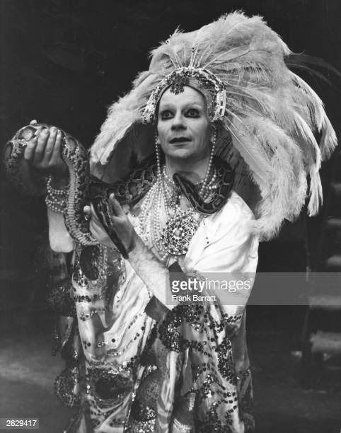 Lindsay Kemp Scottish mime artist actor and director holds a boa constrictor as he plays the title role in 'Salome' at The Round House London