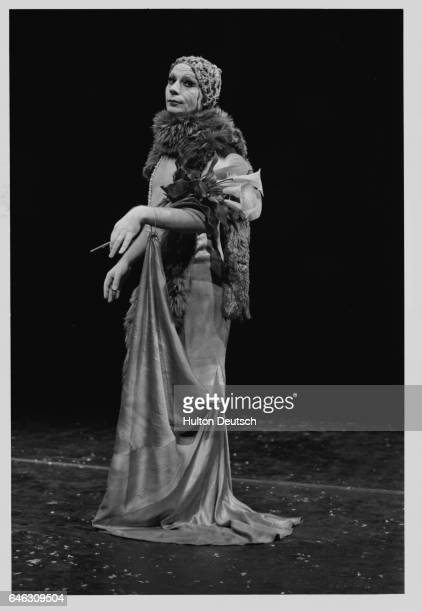 Lindsay Kemp the Scottish mime artist and dancer dons a gown and feather boa for his starring role in Flowers