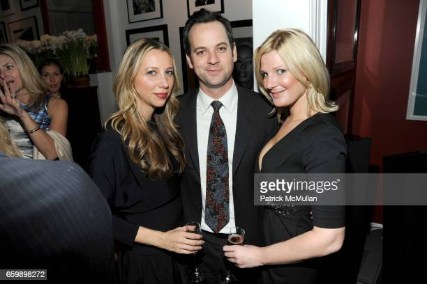 Lindsay Leaf Jeff Leaf and Amy Gagnon attend JOHN DEMSEY Holiday Party at Private Residence on December 15 2009 in New York City