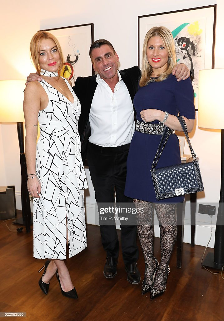 Lindsay Lohan, Alessandro Grassini-Grimaldi and Hofit Golan attend an afternoon tea hosted by Damiani in aid of Nadedza Foundation at Morton's Club on November 9, 2016 in London, England.