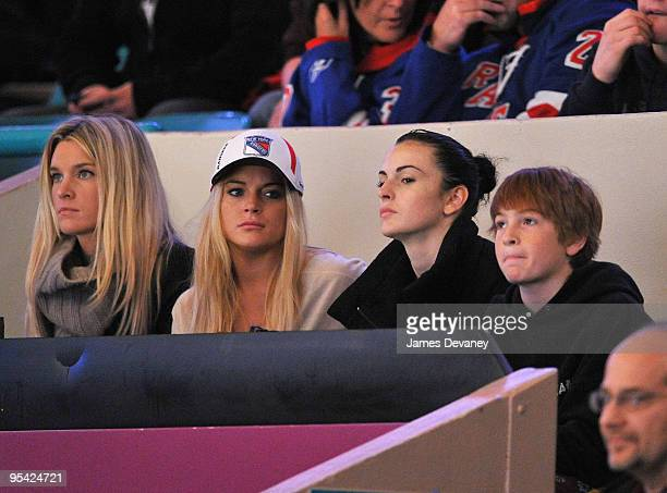 Lindsay Lohan Ali Lohan and Dakota Lohan attend the New York Islanders vs New York Rangers game at Madison Square Garden on December 26 2009 in New...