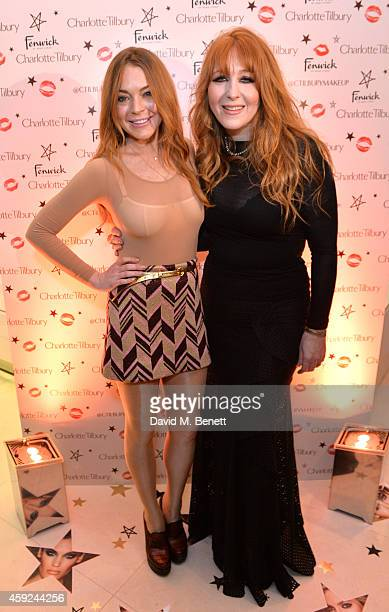 Lindsay Lohan and Charlotte Tilbury attend the launch of Charlotte Tilbury's 'Backstage Beauty Booth' counter in the Beauty Hall at Fenwick Of Bond...